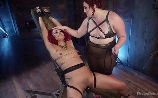 Mimosa and Daisy Ducati play in a BDSM sex dungeon with bondage