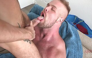 Horny gay Brendan Patrick sits on a friend's fat penis with his ass
