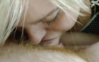 Chubby blonde with tongue piercing sucks cock and gets a facial