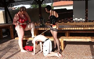 Extraordinary sluts enjoy torturing their skinny male slave all round outdoors